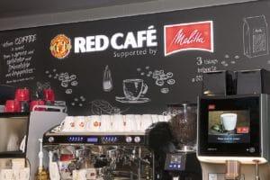 Melitta®: Der Einagng zum Red Café – Supported by Melitta®, Manschester United.