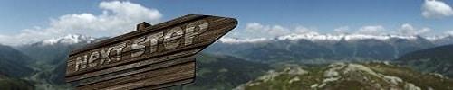 """Auf dem Bild ist ein Wegschild mit der Aufschrift """"Next Step"""" zu sehen. Im Hintergrund befindet sich eine Berglandschaft."""