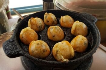 Paddu gefüllte Teigbällchen