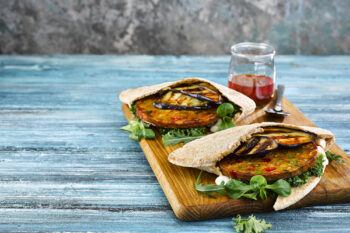 Precooked, uncoated Falafelburger with chick peas, butternut squash and roasted vegetables with chunky bite.