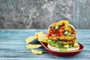 Vegetable-burger with taco-coating, whole kidney beans and corn.