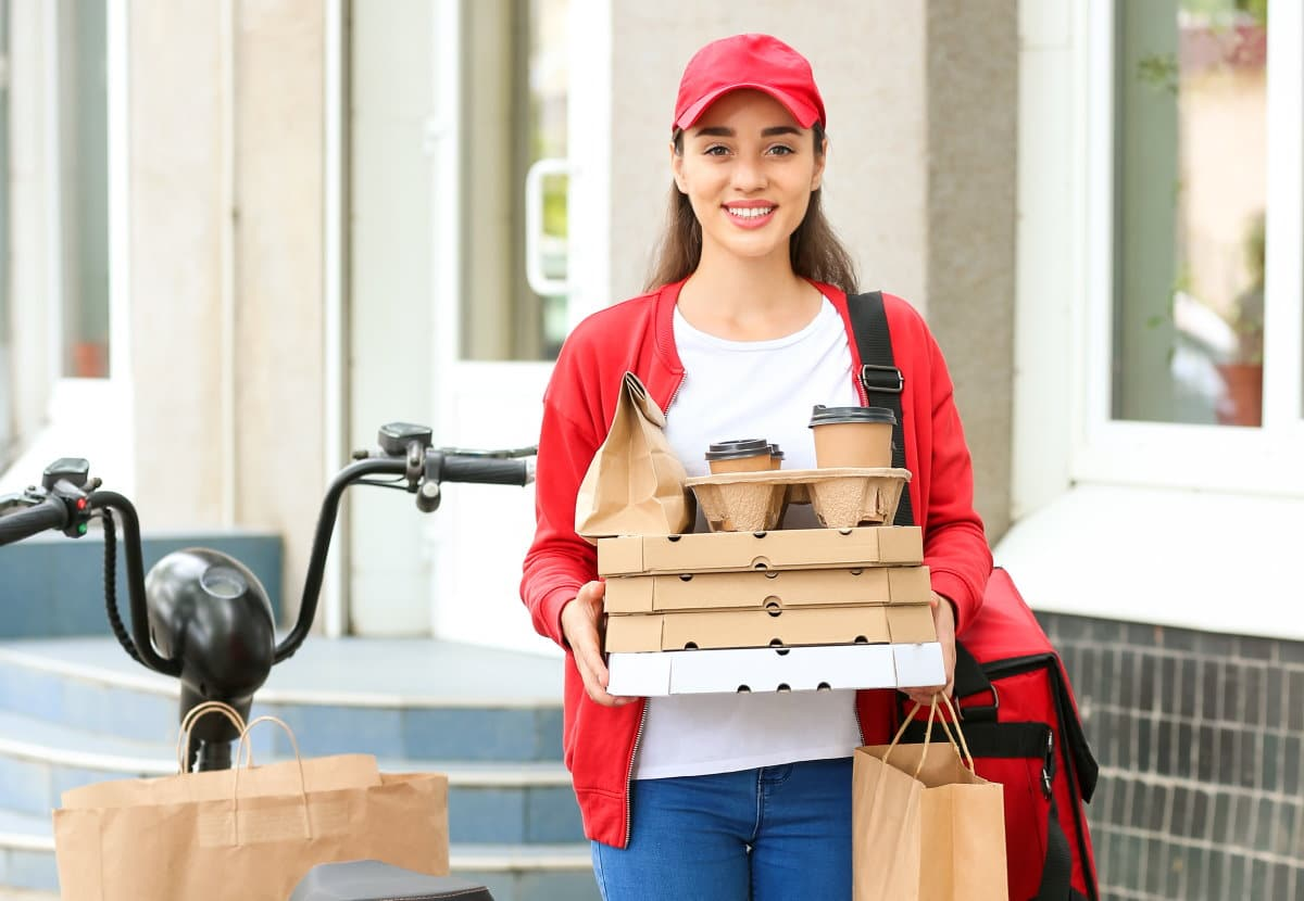 Female worker of food delivery service outdoors / snackconnection