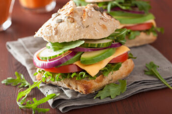 tomato avocado cheese sandwich with cucumber onion / snackconnection