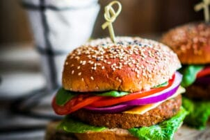 Homemade burgers on rustic wooden background / snackconnection