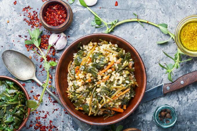 Popular food of the Middle East.Stew bulgur.Bulgur with portulak. / snackconnection